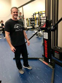 Man standing next to lift equipment