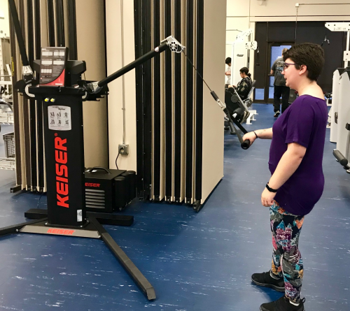 Woman with specialized gym equipment