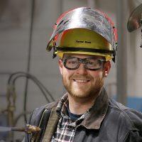 Tanner and Matt Scott in welding shop.