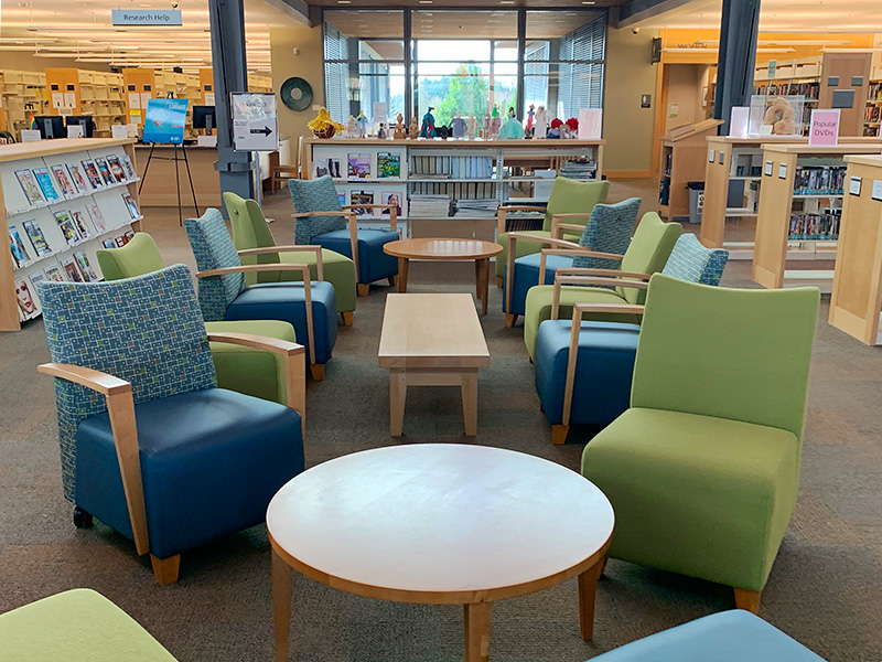 Comfy chairs and tables at the library