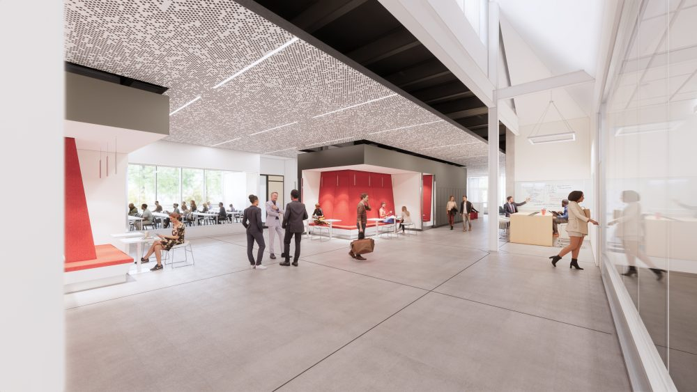 Rendering of interior view of the building, looking at the center circulation space for individual and group study.