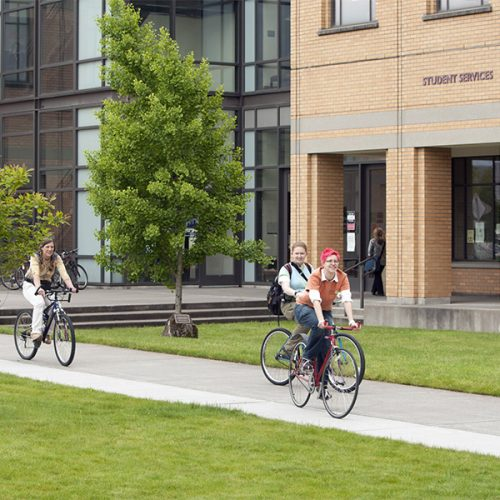 Students riding bikes on Cascade Campus