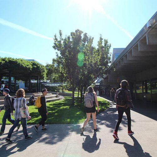 Students walking outside at Sylvania Campus