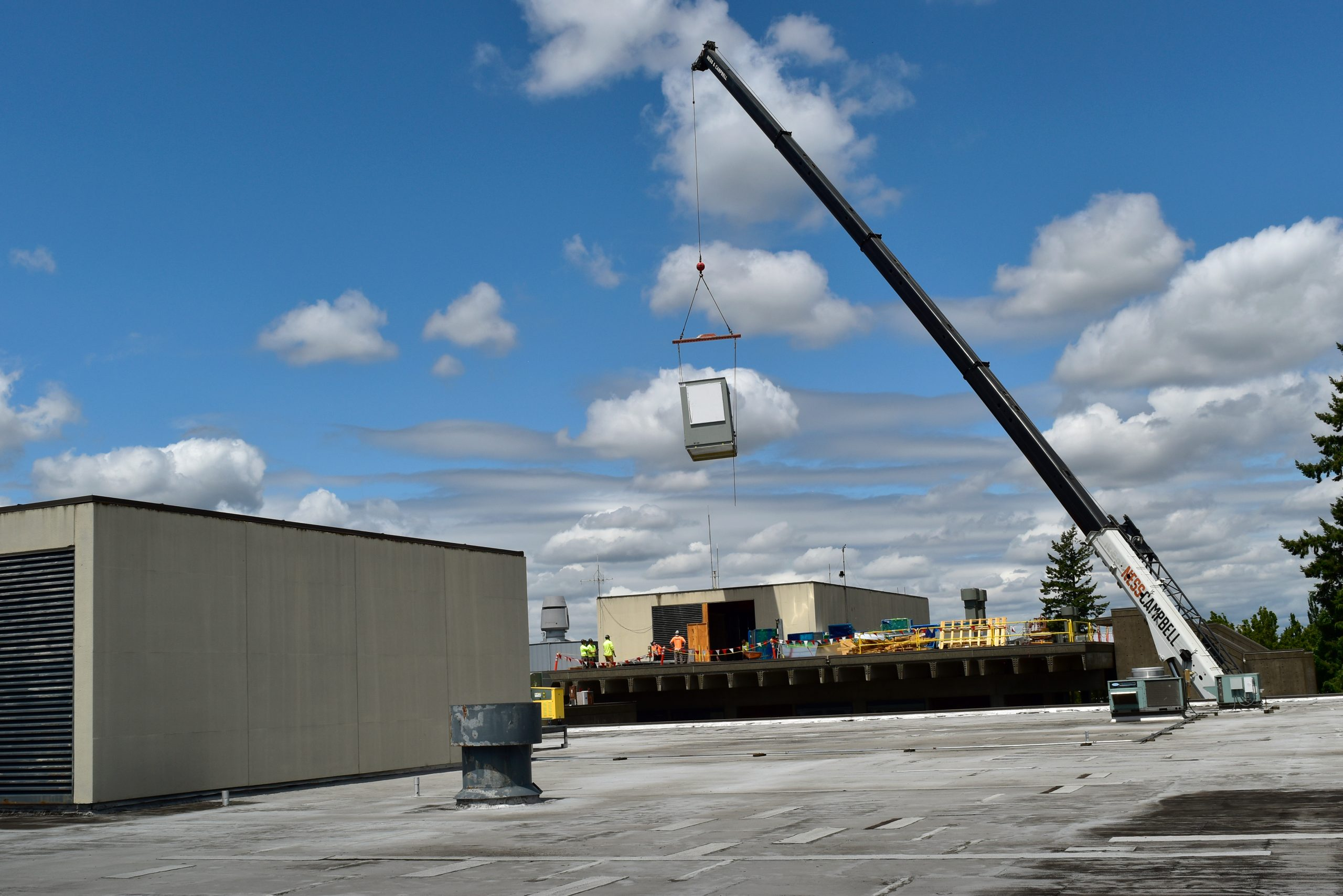 New Air Handler Unit brought up by a crane to the roof of ST building