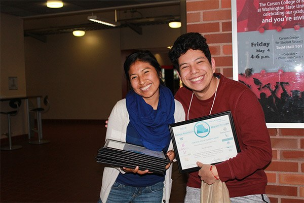 Student holding a certificate of achievement