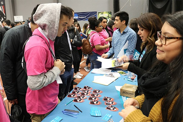 Students running an information table