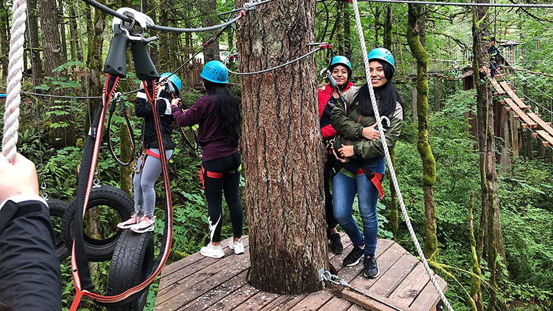 CAMP students during a tree climbing and zipline activity