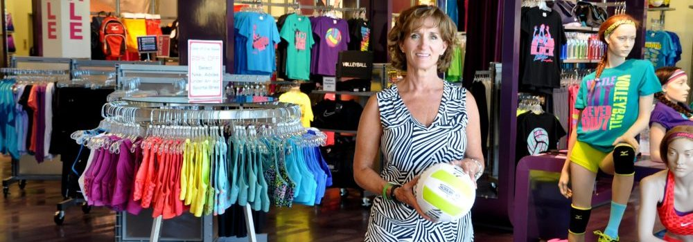 Diana Marsden of Aries Apparel and graduate of Retail Small Business Management at PCC Small Business Development Center poses in her sports apparel store for girls.