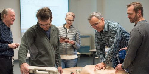 AHA and Cardiology students practice using mannequins in CLIMB classroom