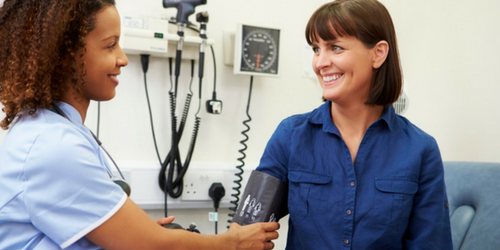 A clinical research team member working with a participant