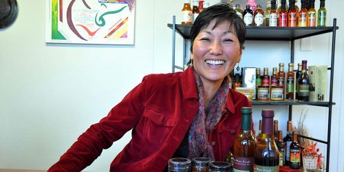 River Wave Foods owner Rebecca Kawanami smiling with her tapenade product line.