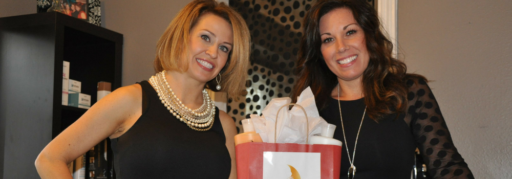 April Orme and DaLynne McIntyre co-owners of Bombshells Salon pose in their hair salon.