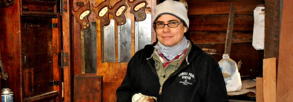 Amy McAuley of Oculus Fine Carpentry stands in her workshop.