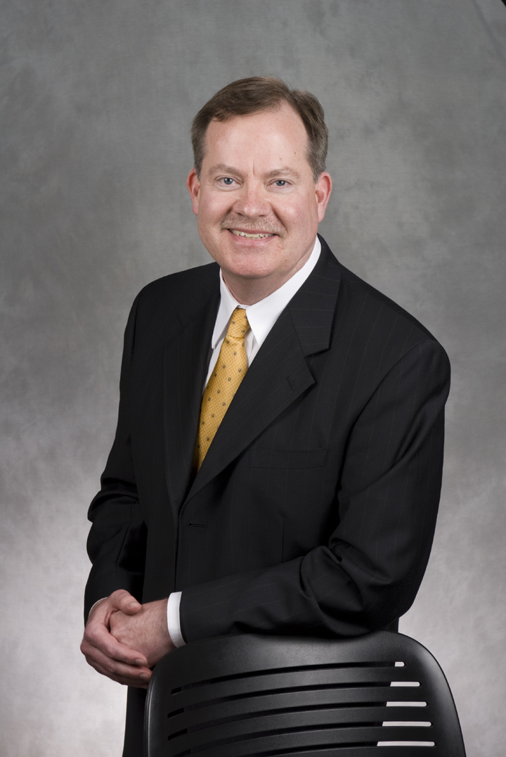 Instructor Jim Foley in a business suit