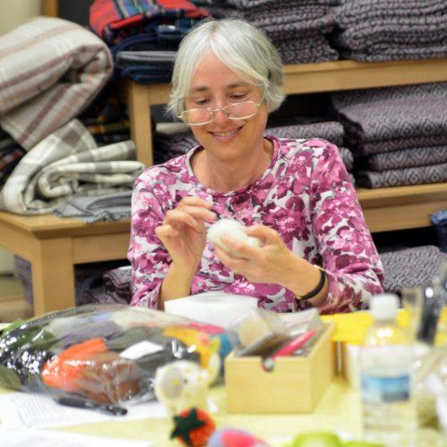 woman demonstrating wool felting