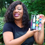 PCC instructor holding teen facepainting kit