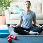 Woman Meditating and practicing yoga at home