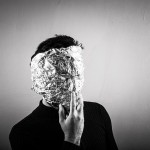 An anonymous student with his face wrapped in aluminium foil.