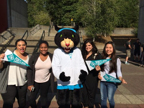 Group of high school students standing with PCC's mascot, Poppe the Panther