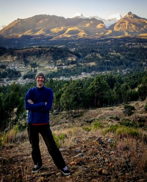 Photo of Chad Sprangel in front of mountains in Peru