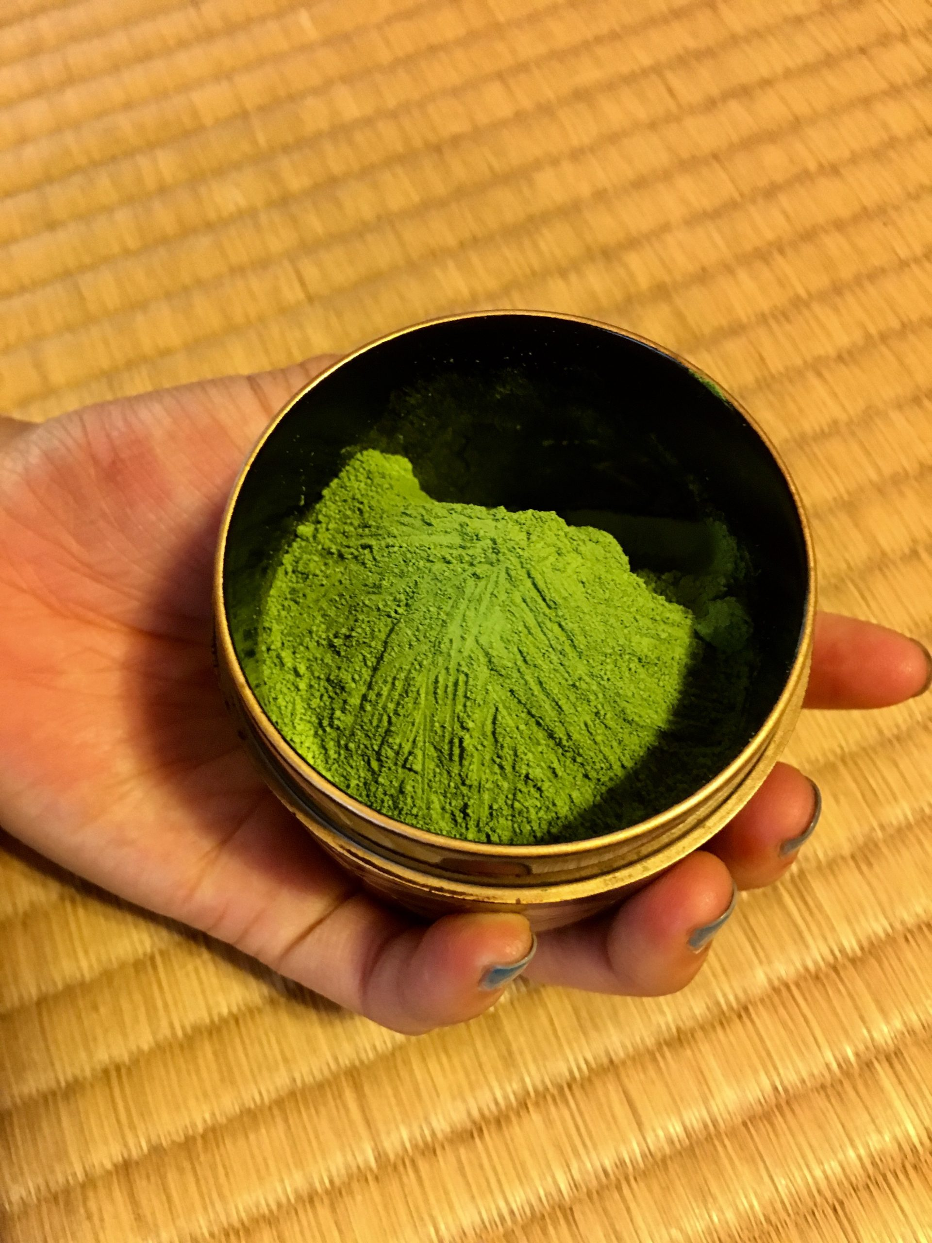 Close up image of green tea grounds