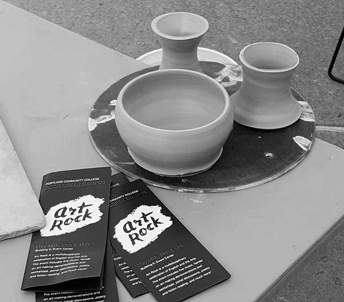 pottery alongside art rock brochures