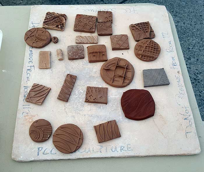 small squares of textured clay