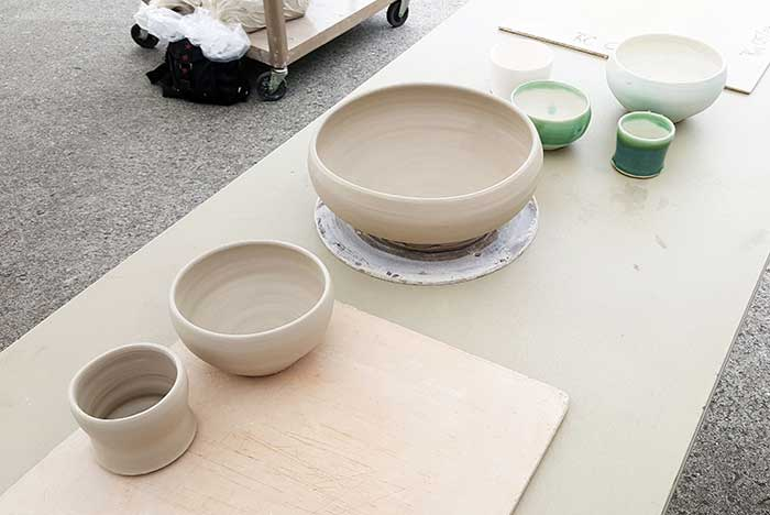 a variety of pottery bowls