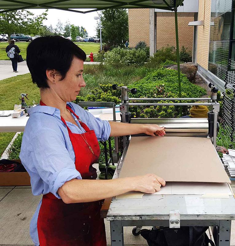 woman using a printing press