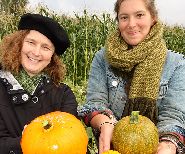 Sustainability staff posing with pumpkins
