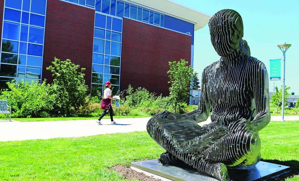 Southeast campus statue of woman sitting