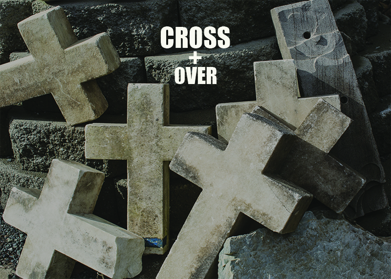 Marble crosses that were former grave markers are loosely piled together.