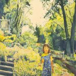Watercolor painting of young girl standing in garden, with steps on the left side, rocks on the right, flowers and trees around and above her. Blue, yellow and green are predominant colors.