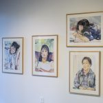 Four framed watercolors hang on gallery wall, each with a portrait of a member of the artist's family