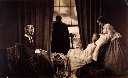 A woman in a bed dying, surrounding by 2 other women
