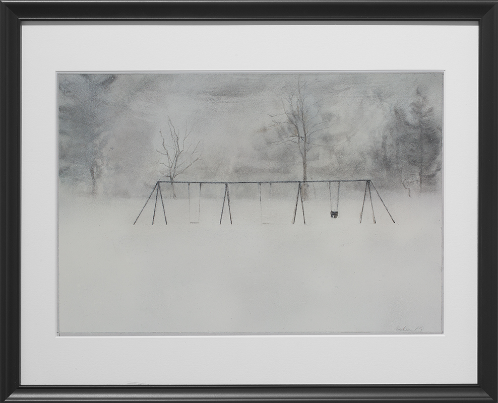 Landscape drawing with black frame. The charcoal drawing is of a swing set in a field of snow. In the foreground of the drawing is white snow. The middle ground depicts three empty swings, with the legs of the structure (drawn as upside down V shapes) in between them and on either end of the structure. In the background are trees. The drawing is in subtle black and white tones and the overall mood of the piece is stillness and quiet.