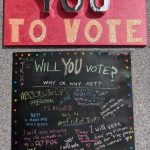 "Katherine Wood, They Don't Want YOU to Vote, 2020, mixed media, ""mirrored"" paper, acrylic paint, glitter, cardboard letters on canvas and poster board, 42"" x 24"""