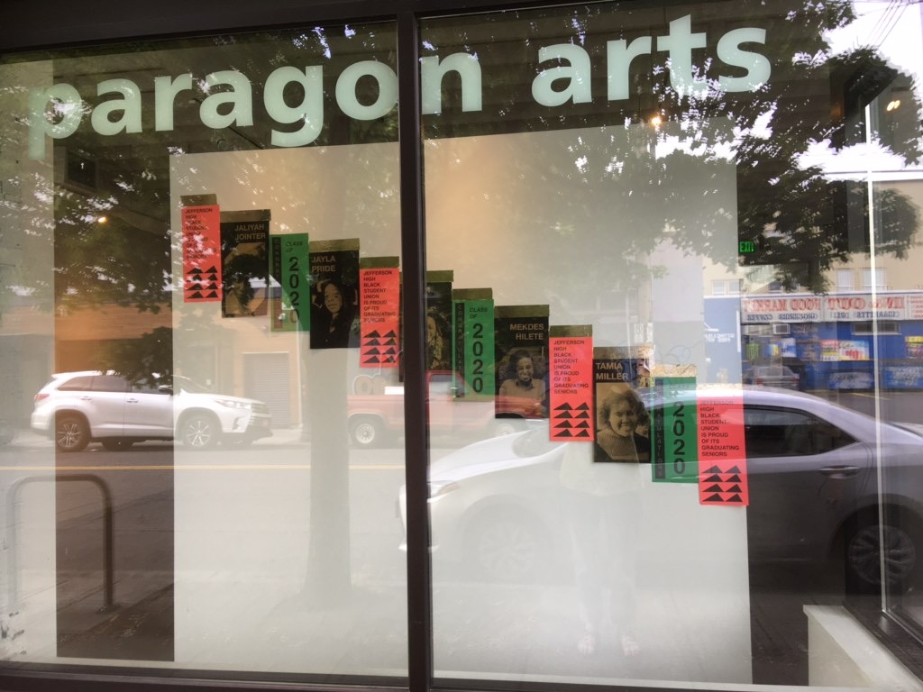 screenprinted posters hanging in the window of the gallery