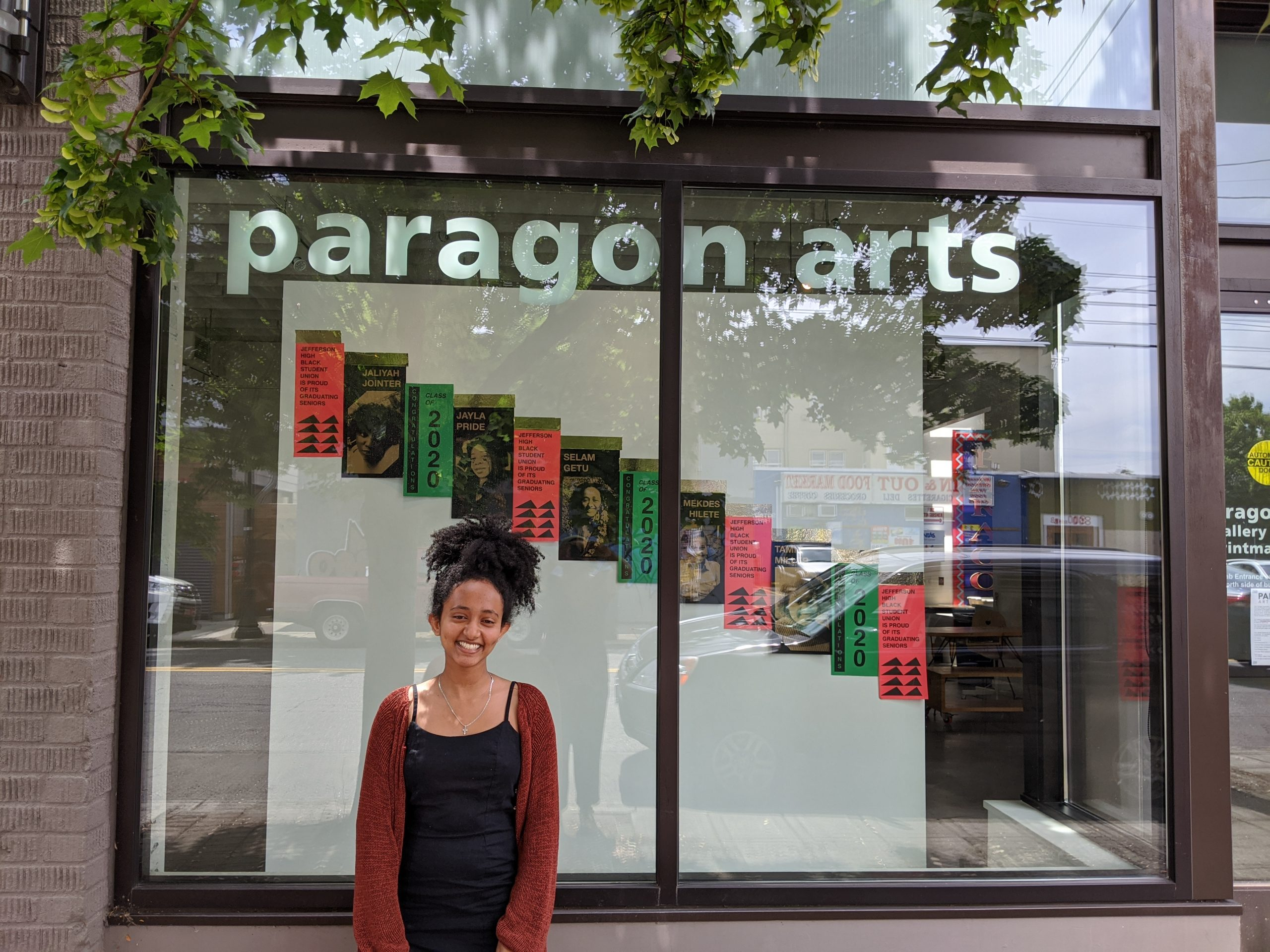 student in front of window exhibition
