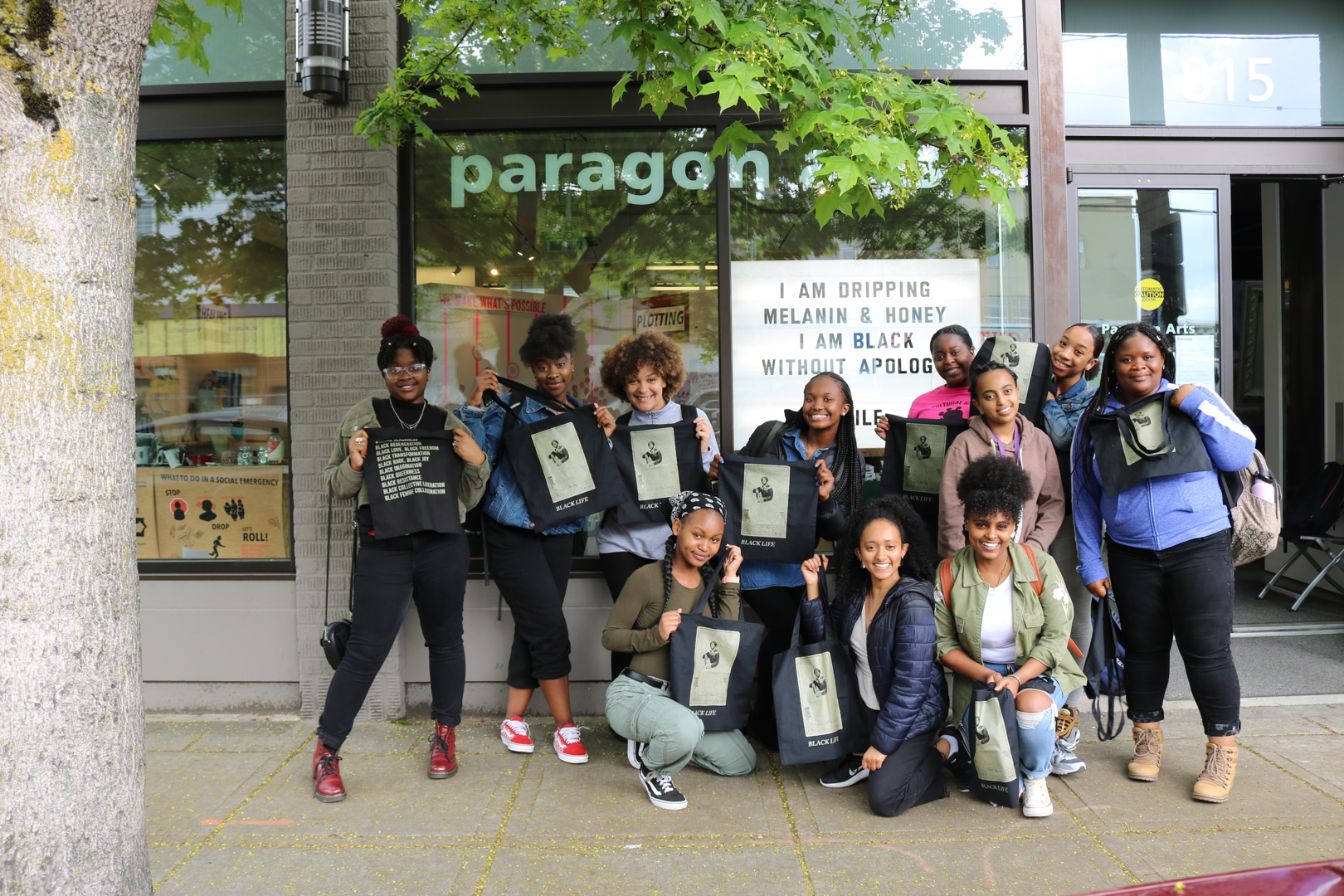 students in front of marquee and gallery window in 2019