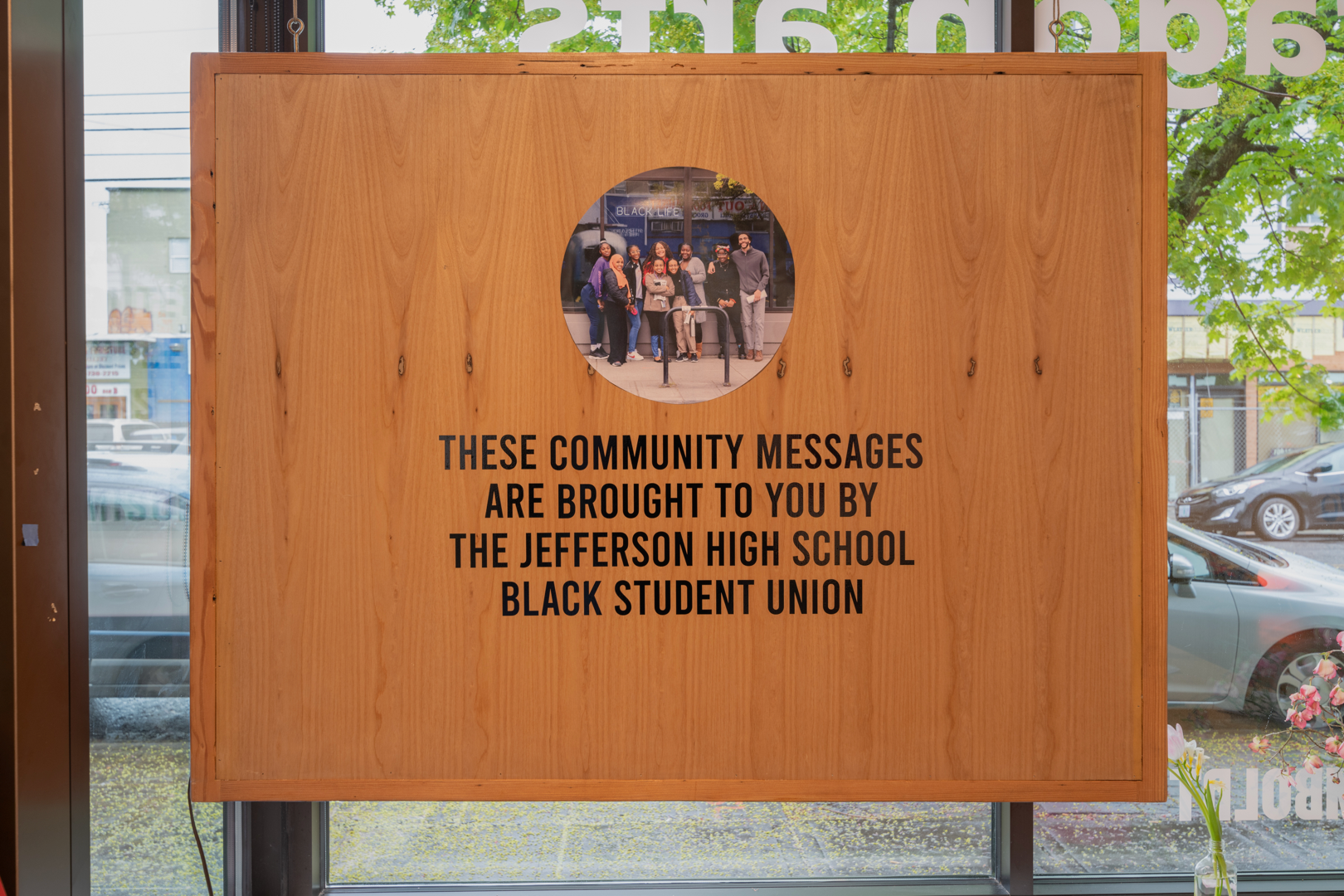 back of marquee sign in gallery window from 2019 exhibition
