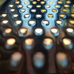 A macro photo of a zester with light coming through the holes.