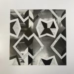 Black and white pattern using cut paper.