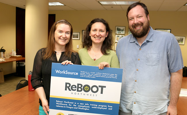 Reboot coaches, including (left to right) Jennifer Poinar and Larisa Felty of PCC, and Sam Wilson of SE Works, welcome all qualified unemployed and underemployed workers to the new program to get a needed reboot on their careers