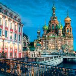 Photograph of buildings, a bridge, St. Basil's cathedral in St. Petersburg, Russia