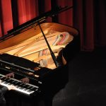 Decorative image of Grand Piano in Performing Arts Center