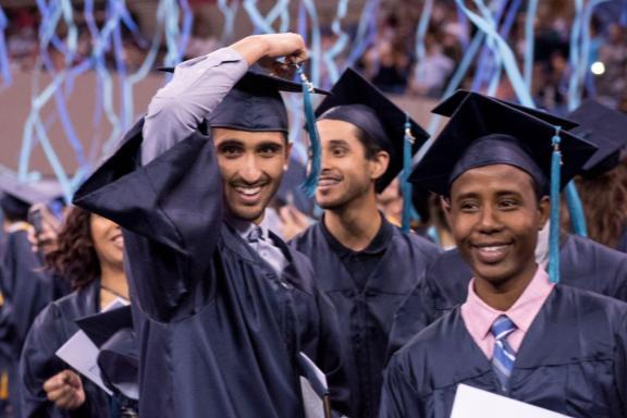grad with cap and confetti