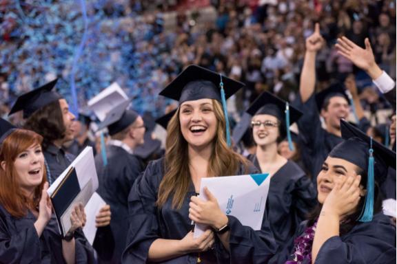 clapping smiling graduates
