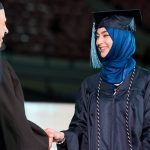 graduating female student with hijab