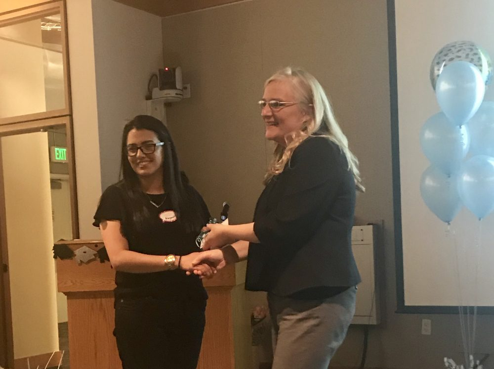 Districi Director, Allison Blizzard, awarding an international student